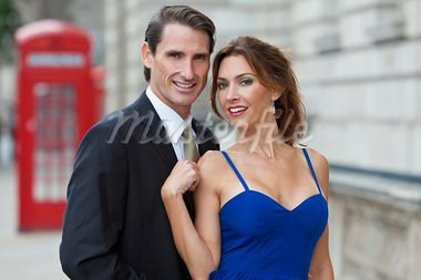 Romantic man and woman couple by a traditional red phone box, London, England, Great Britain Stock Photo - Royalty-Free, Artist: darrenbaker                   , Code: 400-05932505