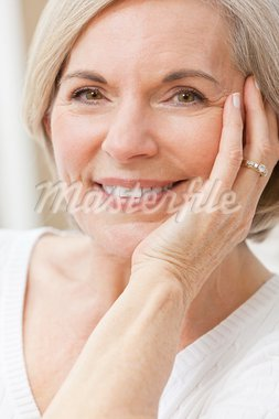 Portrait of an attractive elegant senior woman relaxing at home. Stock Photo - Royalty-Free, Artist: darrenbaker                   , Code: 400-05932507