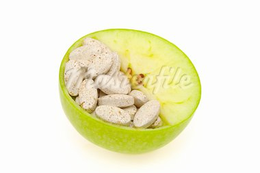 Close up of apple and pills isolated - vitamin concept Stock Photo - Royalty-Free, Artist: brozova                       , Code: 400-05936773