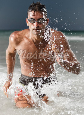 Swimmer Running out of Water, Miami Beach, Florida, USA Stock Photo - Premium Royalty-Free, Artist: Peter Barrett, Code: 600-05947642