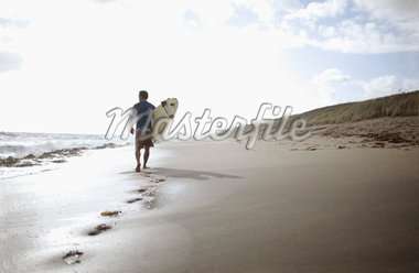 Surfer Walking on Beach Stock Photo - Premium Rights-Managed, Artist: Peter Barrett, Code: 700-05947671