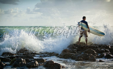 Surfer Standing on Rocks with Rough Seas Stock Photo - Premium Rights-Managed, Artist: Peter Barrett, Code: 700-05947674