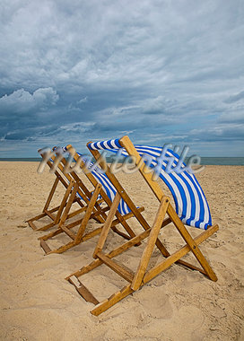 Lawn chairs blowing in wind on beach Stock Photo - Premium Royalty-Freenull, Code: 649-05949450