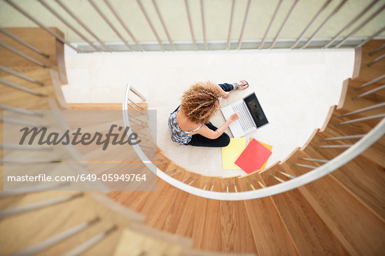 Woman using laptop on floor Stock Photo - Premium Royalty-Freenull, Code: 649-05949764