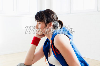 Woman sitting on floor after workout Stock Photo - Premium Royalty-Freenull, Code: 649-05949781