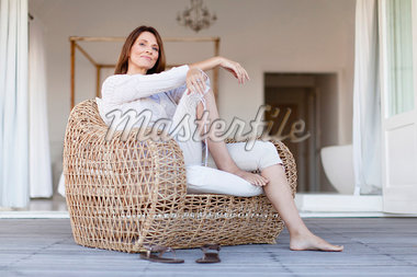 Older woman relaxing in armchair Stock Photo - Premium Royalty-Freenull, Code: 649-05949911