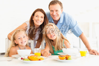 Family smiling at breakfast table Stock Photo - Premium Royalty-Freenull, Code: 649-05949963