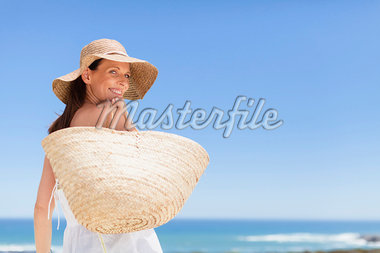Woman carrying straw bag outdoors Stock Photo - Premium Royalty-Freenull, Code: 649-05949977