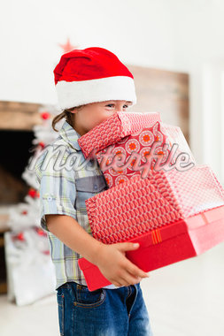 Boy in Santa hat with Christmas gifts Stock Photo - Premium Royalty-Freenull, Code: 649-05950003
