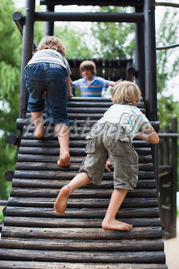 Boys playing on play structure together Stock Photo - Premium Royalty-Freenull, Code: 649-05950129