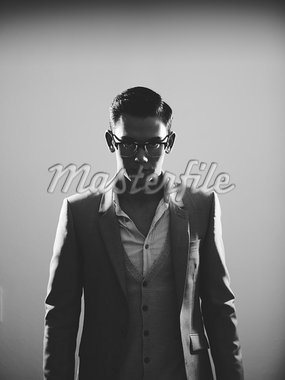 Businessman in suit and glasses Stock Photo - Premium Royalty-Freenull, Code: 649-05950427