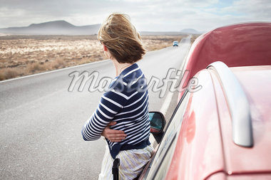 Woman with broken down car on rural road Stock Photo - Premium Royalty-Freenull, Code: 649-05950789