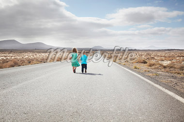 Children walking on paved rural road Stock Photo - Premium Royalty-Freenull, Code: 649-05950798