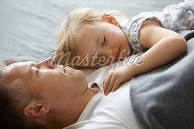 Father and daughter sleeping on sofa Stock Photo - Premium Royalty-Freenull, Code: 649-05950983