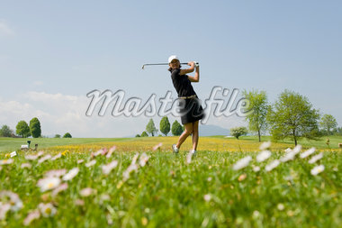 Woman Playing Golf Stock Photo - Premium Rights-Managed, Artist: Bettina Salomon, Code: 700-05969968