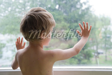 Boy with Chicken Pox Looking Out Window Stock Photo - Premium Rights-Managed, Artist: Bettina Salomon, Code: 700-05969972