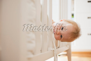 Baby Girl Looking out from Crib Stock Photo - Premium Royalty-Free, Artist: I. Jonsson, Code: 600-05973075