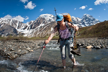 Female backpacker crossing the Babel River below South Buttress on the western flanks of the Revelation Mountains, Summer in Southcentral Alaska Stock Photo - Premium Rights-Managed, Artist: AlaskaStock, Code: 854-05974574