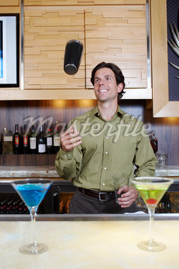 Bartender Tossing Shaker in the Air Stock Photo - Premium Royalty-Freenull, Code: 693-06021223