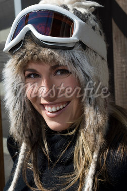 Skier Wearing Goggles and Fur Ski Hat Stock Photo - Premium Royalty-Freenull, Code: 693-06021227