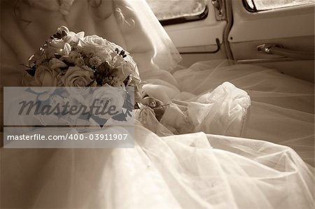 The bride with a bouquet in the retro automobile. Style retro Stock Photo - Budget Royalty-Free, Image code: 400-03911907