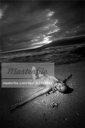 Young Caucasian nude woman wearing lei lying on beach in Maui, Hawaii, USA. Stock Photo - Budget Royalty-Free, Image code: 400-03924883