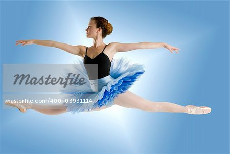 dancer in blue tutu jumpig on a shining blue background Stock Photo - Budget Royalty-Free, Image code: 400-03931114