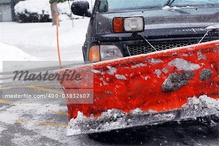 Snow plow truck on a road during a snowstorm Stock Photo - Budget Royalty-Free, Image code: 400-03932607