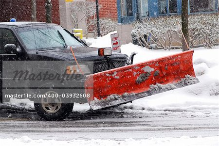Snow plow truck on a road during a snowstorm Stock Photo - Budget Royalty-Free, Image code: 400-03932608