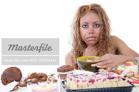 Pretty black girl feeling very ill after having eaten too much sweets Stock Photo - Budget Royalty-Free, Image code: 400-03936414