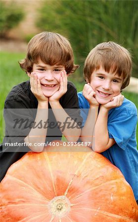 Two Boys Resting on a Huge Pumpkin Stock Photo - Budget Royalty-Free, Image code: 400-03936487