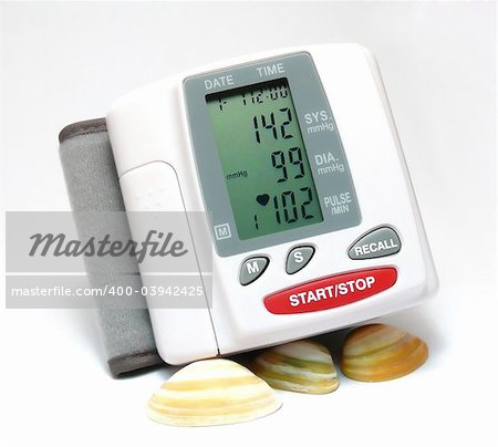 Closeup of a blood pressure measuring device supported by some seashells Stock Photo - Budget Royalty-Free, Image code: 400-03942425