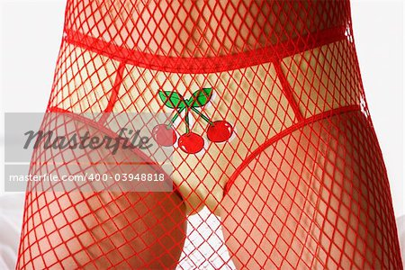 Caucasian woman wearing briefs with cherries and mesh covering body. Stock Photo - Budget Royalty-Free, Image code: 400-03948818