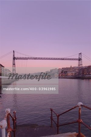 Suspension bridge of Bizkaia growing dark from getxo Stock Photo - Budget Royalty-Free, Image code: 400-03961985