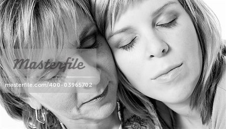 A portrait taken from mother and daughter taken on a white background Stock Photo - Budget Royalty-Free, Image code: 400-03965702