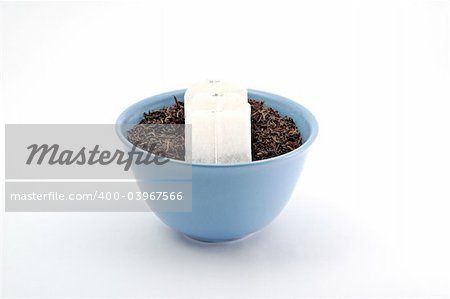 Tea leafs and bags in blue bowl Stock Photo - Budget Royalty-Free, Image code: 400-03967566