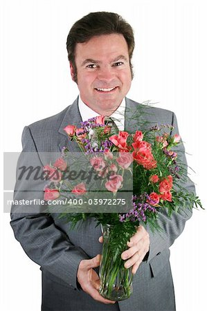 A handsome businessman holding a bouquet of roses for his wife, girlfriend, or secretary. Stock Photo - Budget Royalty-Free, Image code: 400-03972275