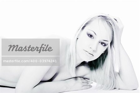 Studio portrait of a young blond woman lying down naked Stock Photo - Budget Royalty-Free, Image code: 400-03974241