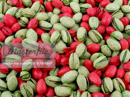 Mixed red-dyed and tequila lime pistachio nuts