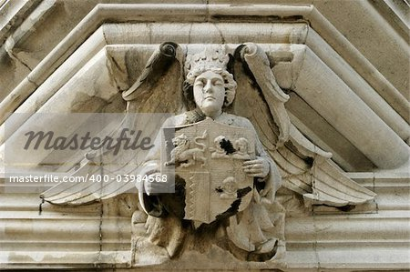 An architectural detail with an angel showing a family crest. This sculpture was located over the main door of an old mansion in the Irish countryside.