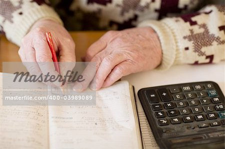 close-up of old man hand writing Stock Photo - Budget Royalty-Free, Image code: 400-03989089