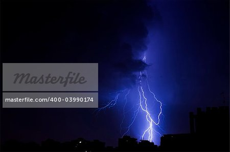 Lightning bolt over the city at the night
