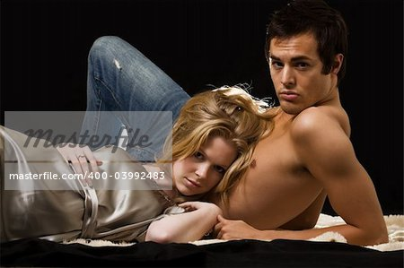 Attractive young blond woman laying on the bare chest of attractive young brunette man Stock Photo - Budget Royalty-Free, Image code: 400-03992483