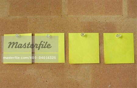four yellow notes pinned in line