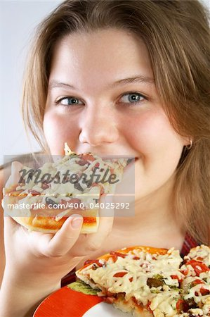 Beautiful no make-up girl eating a piece of Pizza Stock Photo - Budget Royalty-Free, Image code: 400-04025292