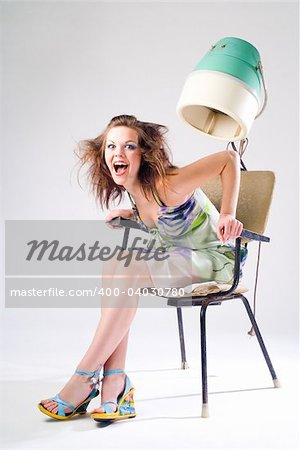 Expressive pretty girl in dress with hair dryer Stock Photo - Budget Royalty-Free, Image code: 400-04030780