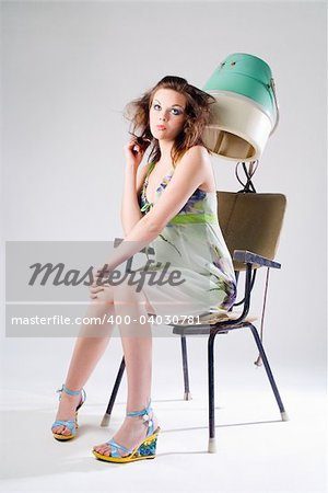 Sad pretty girl in dress with hair dryer Stock Photo - Budget Royalty-Free, Image code: 400-04030781