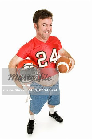 Middle aged man in his highschool football uniform, reliving his youth. Stock Photo - Budget Royalty-Free, Image code: 400-04040334