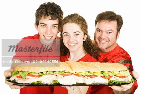 Football fans holding a giant submarine sandwich.  Isolated on white. Stock Photo - Budget Royalty-Free, Image code: 400-04040336