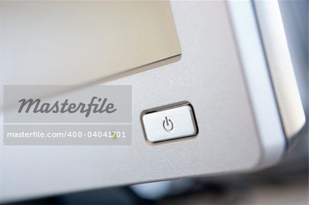 Shot of a power button on a computer monitor Stock Photo - Royalty-Free, Artist: MonkeyBusinessImages, Code: 400-04041701